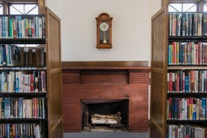 Fireplace flanked by books